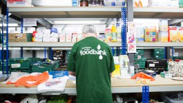A volunteer sorts foodbank donations in the Midlands
